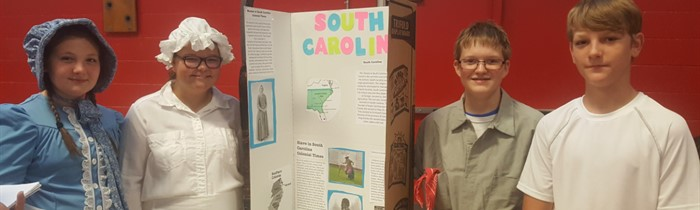 HCMS 2017-18 Colonial Fair--settlers from the colony of South Carolina were (l to r) Lillian Tudor, Erika Morton, Jarrett Caldwell and Roper Baker.